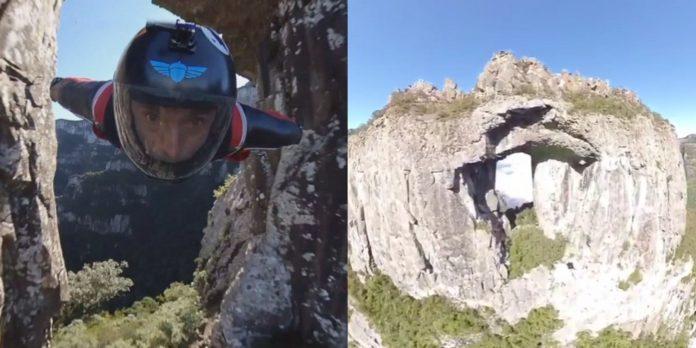 Vídeo: Brasileiro faz o primeiro voo de wingsuit em uma pedra furada na América do Sul