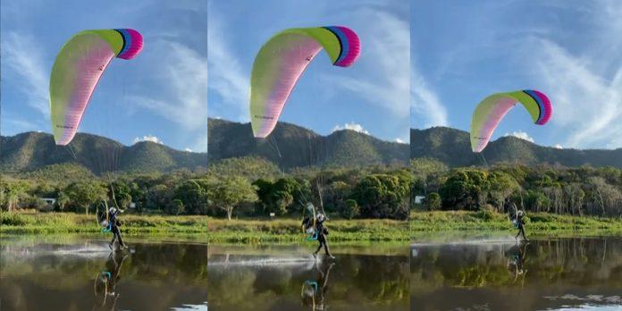Vídeo: Homem desliza sobre as águas do rio Paraguai com parapente no Pantanal